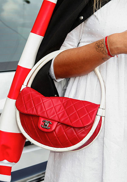 It doesn't have to be Chanel's hula hoop bag, a statement arm candy would do.