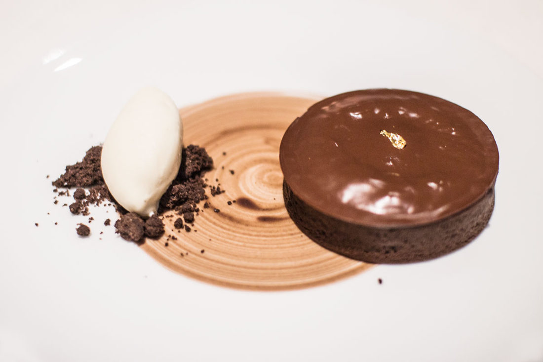 Warm dark chocolate tart with salted caramel and vanilla ice cream