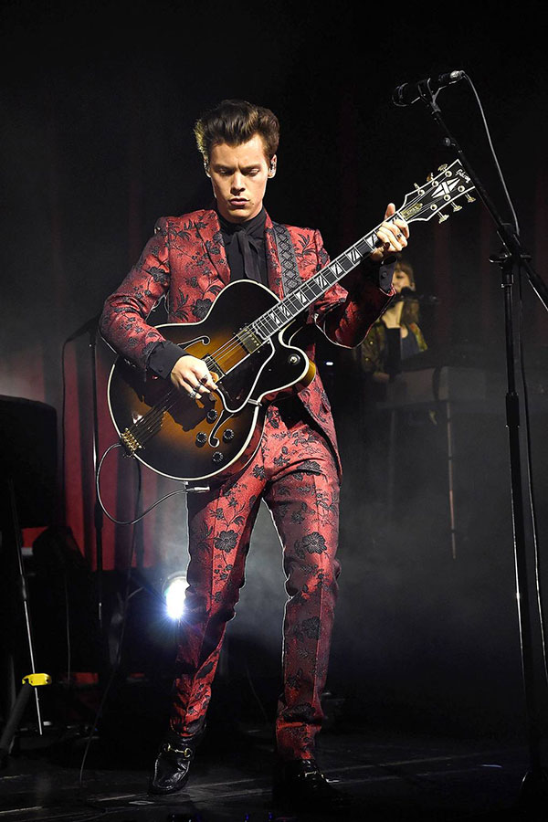 Harry Styles in custome red Gucci suit