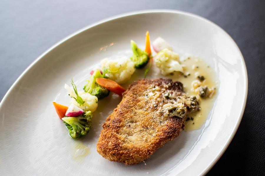 Lemon sole fish Milanese style served with sautéed vegetables & lemon
