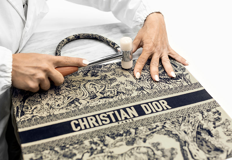 10dc854af5e The five individual Dior Book Tote pieces are inspected before they are  relayed to the Maison's leatherworking ateliers in Florentine. There, the  bag is ...