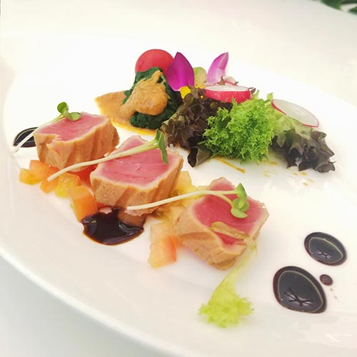 Grilled tuna with seasonal vegetables and avocado