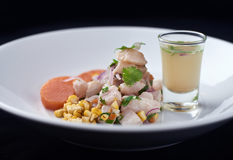 Ceviche - Marinated red snapper on lime and lemon juice, fresh corn, cilantro, red onions and habanero chile